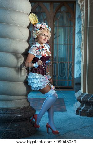 Girl In Ancient Dress Standing Near Vintage Column.