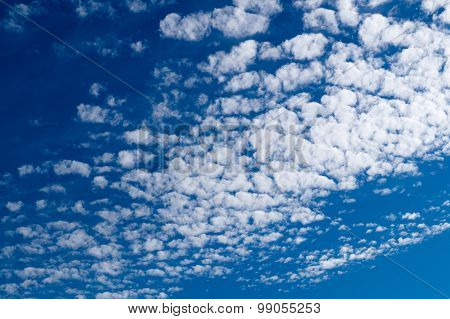 Altocumulus Clouds In Blue Sky On Sunny Peaceful Day