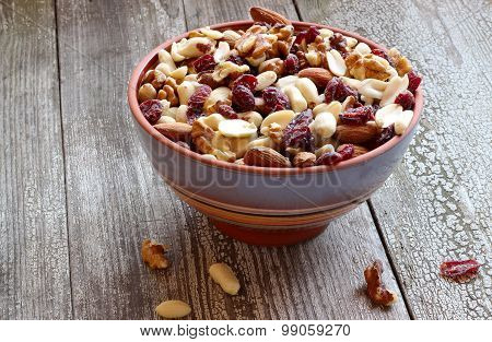Mix Of Dried Fruits And Nuts In A Ceramic Bowl