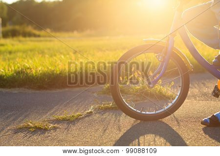 child riding bike at sunset