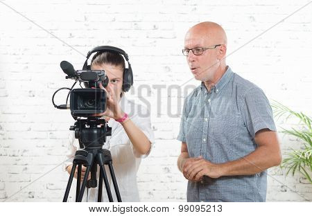 a young woman cameraman, and the trainer