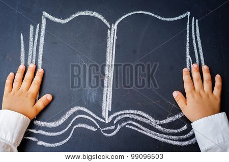 Baby Hands Holding A Book Drawing On The Board