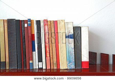 books on wooden bookshelf