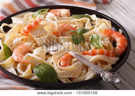Fettuccini Pasta In Cream Sauce With Shrimp Close-up. Horizontal