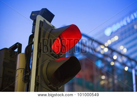 LONDON, UK - 7 SEPTEMBER, 2015: Canary Wharf traffic lights showing red and Barclays bank building o