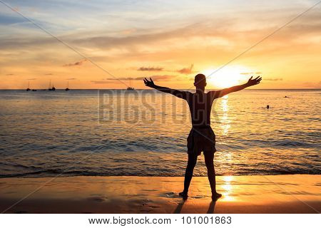 African  Men Raising Arms Up  At Sunset In Tarrafal Beach In Santiago Island In Cape Verde - Cabo Ve