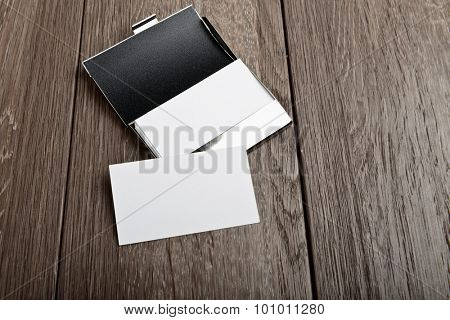 Business card and cardholder on wooden table
