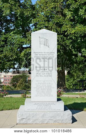DES MOINES, IOWA - AUGUST 20, 2015: Iowa Revolutionary War Monument. The monument commemorates the 39 Revolutionary War veterans who are buried in the State of Iowa.