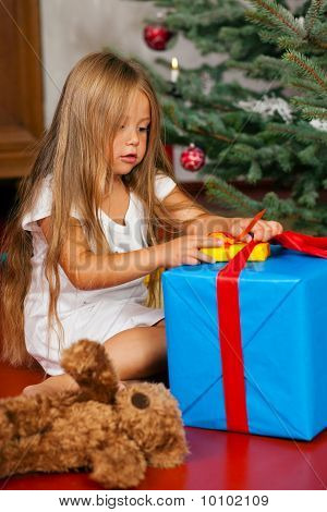 Child opening Christmas presents