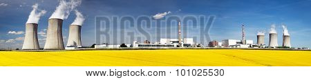 Nuclear Power Plant Dukovany With Golden Glowering Field
