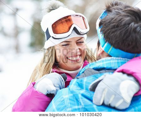 Happy smiling couple togther in a winter holiday with ski googles