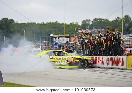 Elkhart Lake, WI - Aug 29, 2015:  Paul Menard (33) celebrates with a burnout after winning the Road America 180 Road America in Elkhart Lake, WI.