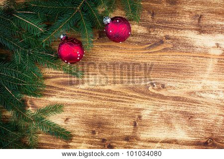 Christmas Fir Tree With Red Christmas Ball On Rustic Wooden Board
