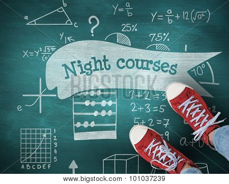 The word night courses and casual shoes against green chalkboard