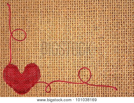Red Heart Over Linen Texture Background