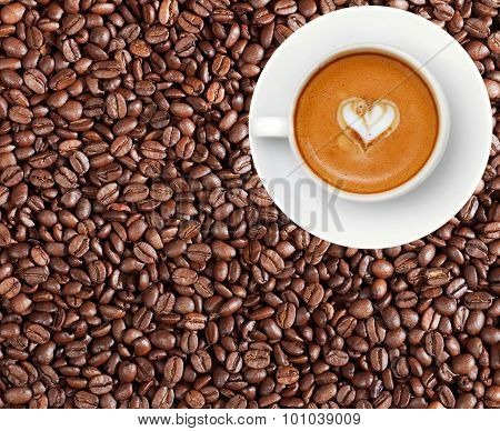 Close-up Of Coffee Beans And Cup Of Coffee Latte