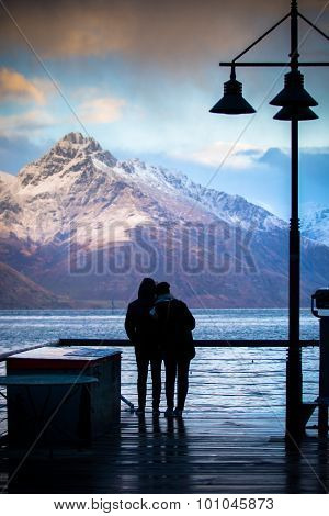 Silhouette Of Couples Love Standing In Wakatipu Lake View Point In Queen Town South Island New Zeala