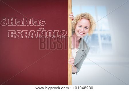 Woman showing card against bright white room with windows