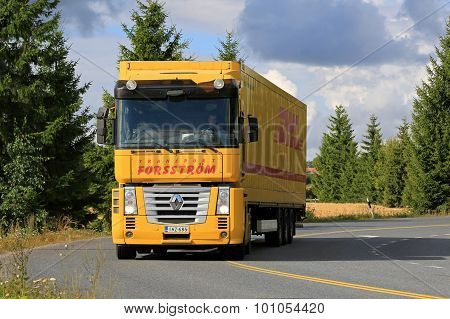 Yellow Renault Magnum Semi Truck On The Road