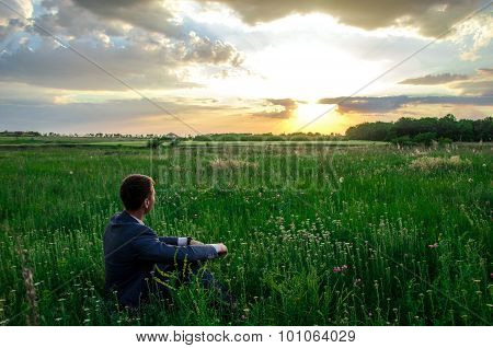 Buisnessman Look To Sunset On The Grass