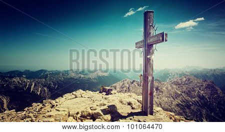 Panoramic View of Summit Cross and Mountain Ranges in Allgau Alps near Germany-Austria Border on Sunny Day with Blue Sky