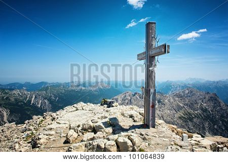 Summit Cross on High Mountain Top in Allgau Alps on Sunny Day with Blue Sky with Overview of Mountain Ranges in Distance, Near Germany-Austria Border
