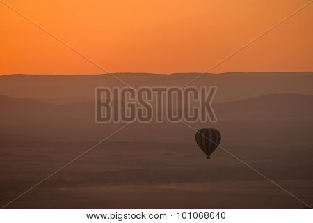 Striped Balloon Over Purple Hills Before Dawn