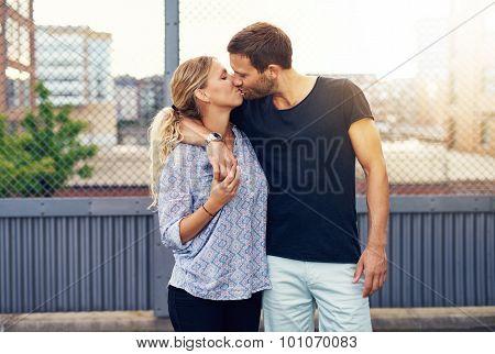 Loving Demonstrative Man Kissing His Girlfriend