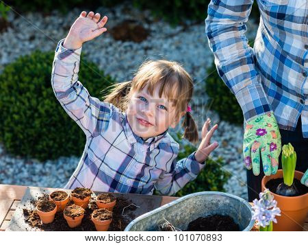 Girl Planting Flower Bulbs