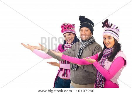 Happy Group In Winter Clothes Welcoming