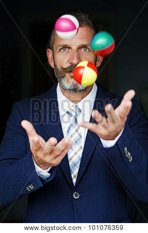 Businessman Juggles Balls