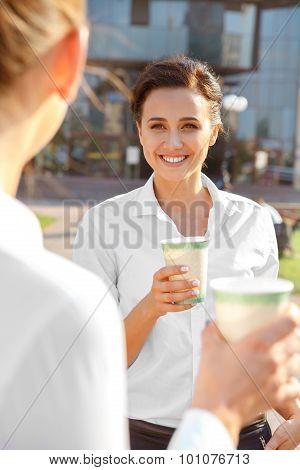 Two businesswoman having a coffee break