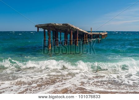 Old ruinous pier on a Black Sea shore