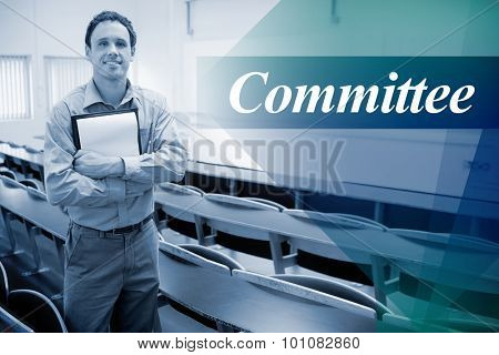 The word committee against male teacher with notepad in the lecture hall