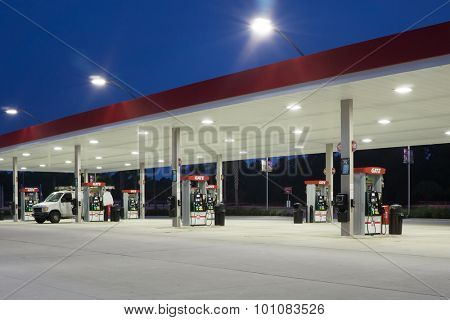 JACKSONVILLE, FLORIDA, USA - AUGUST 5, 2015: A Gate Petroleum gas station at night. Gate Petroleum is headquartered in Jacksonville and has over 225 stations in six states with over 2,200 employees.