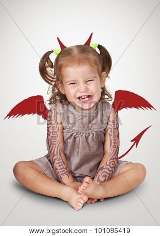 Funny Portrait Of Bad Child With Tatoo And Devil Horns, Disobedient Baby Concept