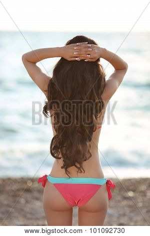 Beautiful Slim Brunette Girl Model Wearing In Fashion Bikini Resting On The Beach. Summer Outdoor Po