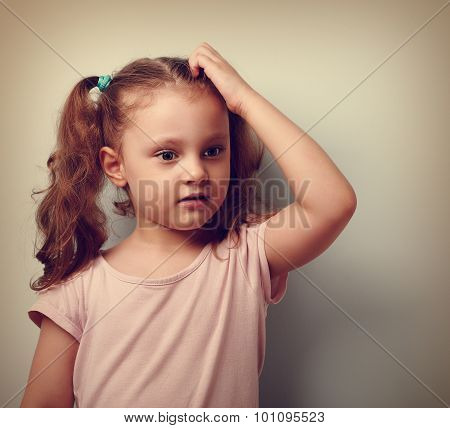 Cute Thinking Worried Kid Girl Sctaching The Head And Looking. Vintage Closeup Portrait