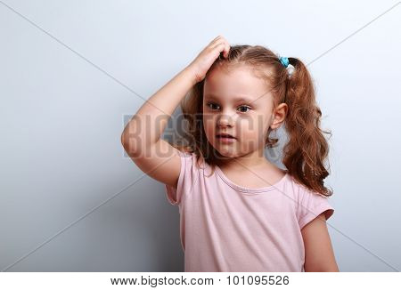 Cute Thinking Worried Kid Girl Sctaching The Head And Looking On Empty Copy Space