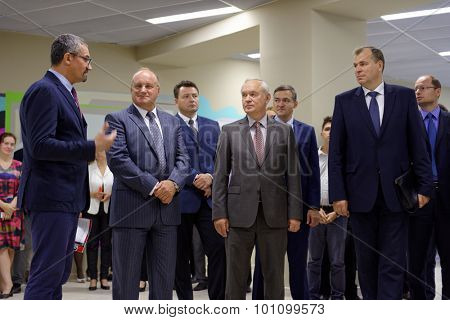 ST. PETERSBURG, RUSSIA - SEPTEMBER 3, 2015: First Vice-rector Alexander Shamrin (center), director of local Campus Sergey Kadochnikov (left), and others during the opening of new academic building