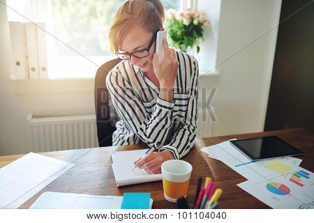 Successful Businesswoman Working In A Home Office