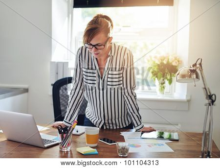 Concerned Businesswoman Studying Her Laptop