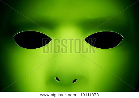 A green face that looks like an alien from Another Planet. poster