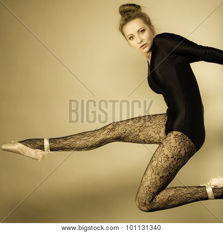 Graceful beautiful woman ballet dancer studio shot sepia vintage aged tone poster