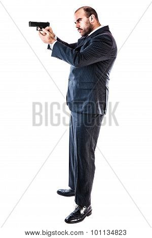 portrait of a classy businessman or mobster or security guard holding a gun isolated over a white background poster