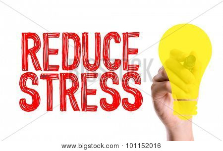 Hand with marker writing the word Reduce Stress
