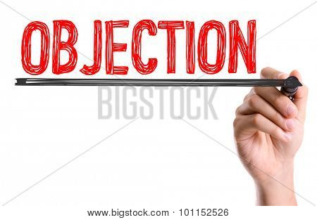 Hand with marker writing the word Objection