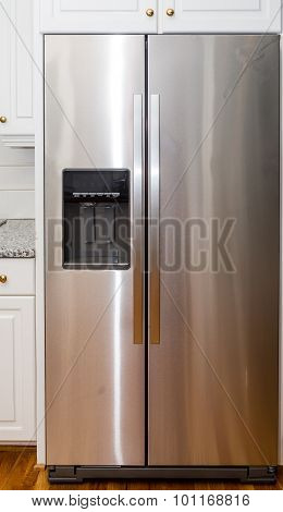 Stainless Steel Refigerator With White Cabinets