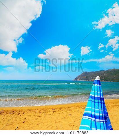 Closed Parasol In Porto Ferro Beach