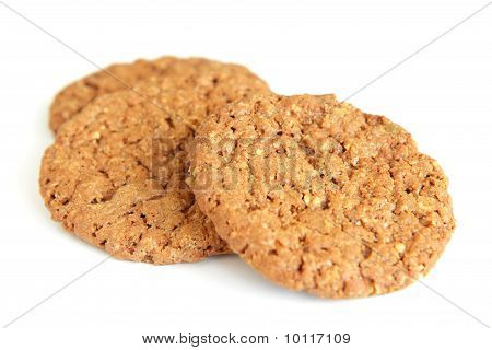 Two oatmeal cookies with chocolate